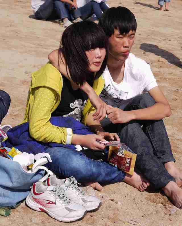 Chinese lovers on the beach