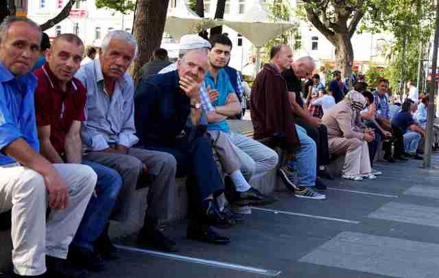 Turkish men hanging out in Ataturk Square