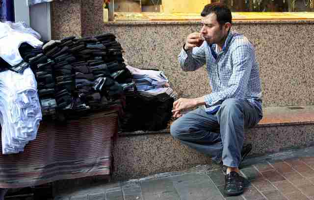 Street trader pausing for tea