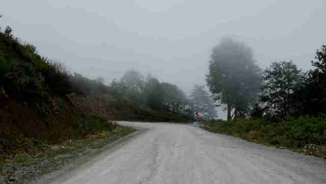 The road turns into a track & the mist arrives
