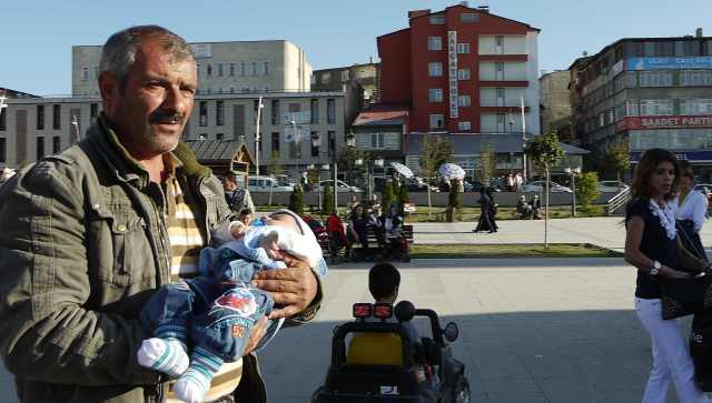 Father and baby ..This pic says alot about Erzurum