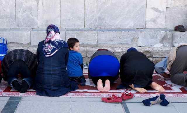 Men and women  praying together