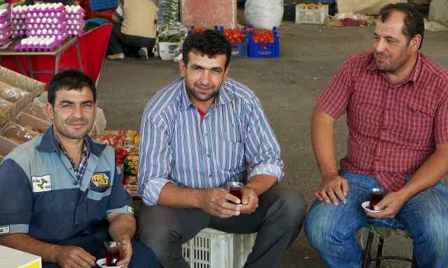 Tea drinkers in the municpal market