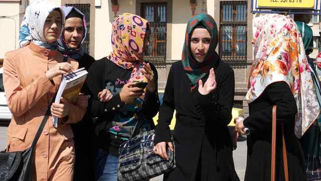 Young women all wearing scarves