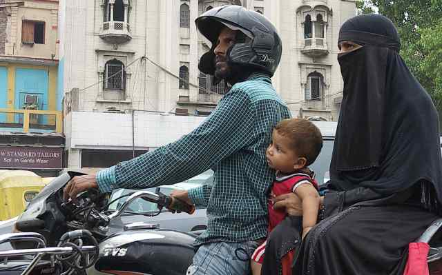 Three on a Bike Muslims