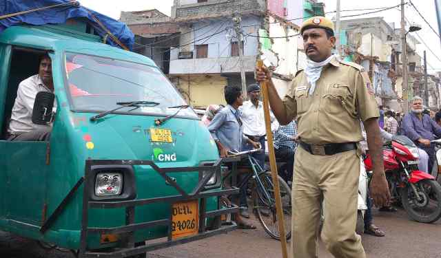 Indian Police with his Lathi