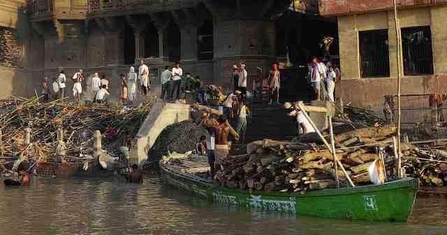 Delivering wood at the burning ghat.
