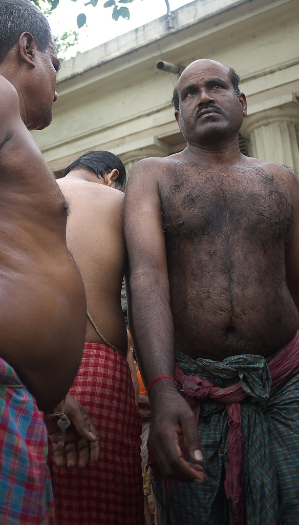 Preparing to bathe in the Hooghly